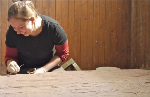 Karolina Kubisz working on a medieval gravestone in the East Church, Cromarty
