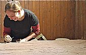 Karolina Kubisz working on the medival gravestone, East Church Cromarty