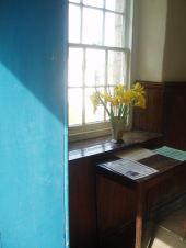 day lilies in church door